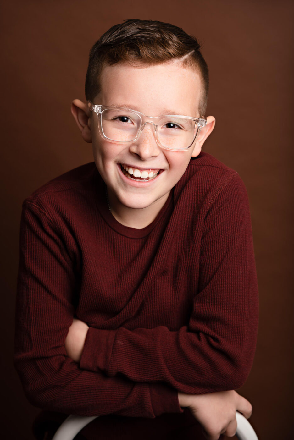Studio portrait of young red headed boy in glasses - photo by Vanessa Guzzo Photography