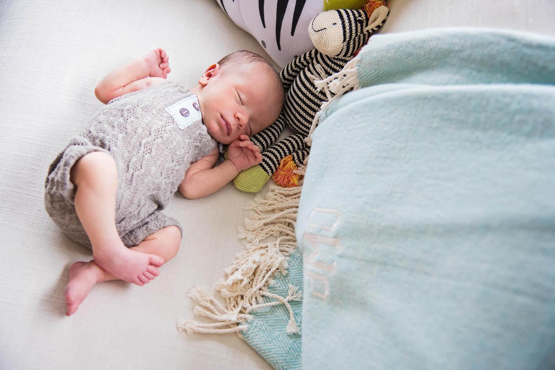 Newborn baby with stuffed animal - photo by Vanessa Guzzo Photography
